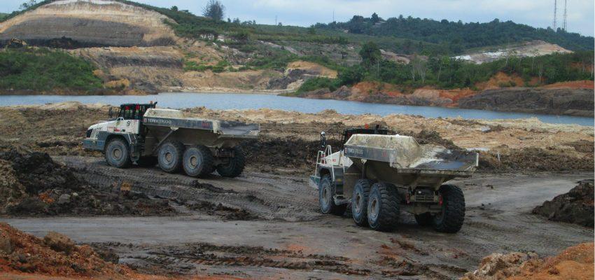 Ten TA400 articulated haulers shift soil in Indonesian mine
