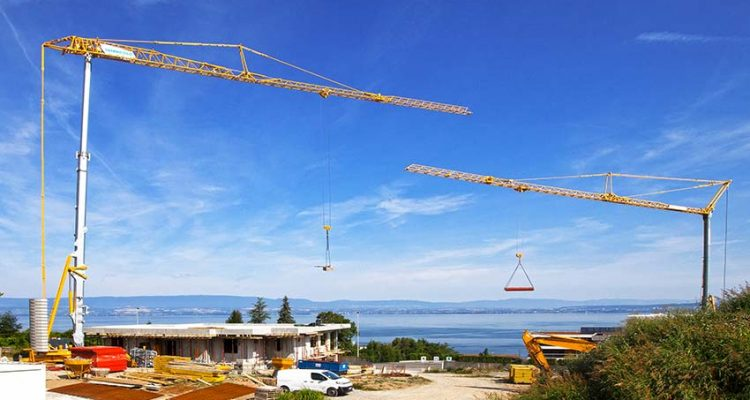 Pair of Potain self-erecting cranes build villas on Lake Geneva